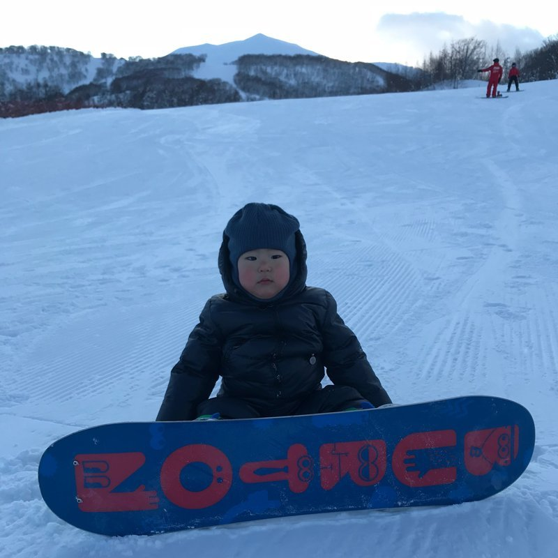 Kahi and her family having fun with snowboard