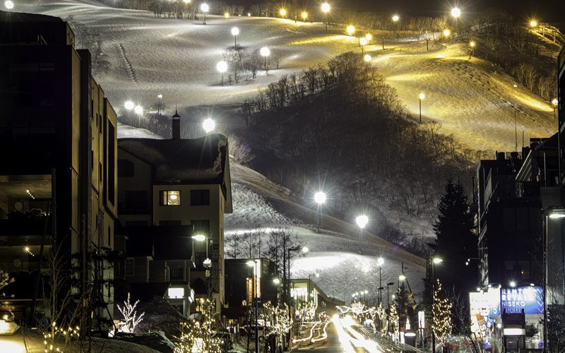 Hirafu night skiing and the main intersection by Daniel Honda