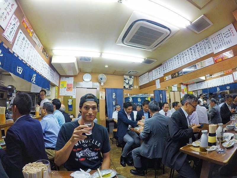 Evan Wilcox trying to blend in a tokyo izakaya